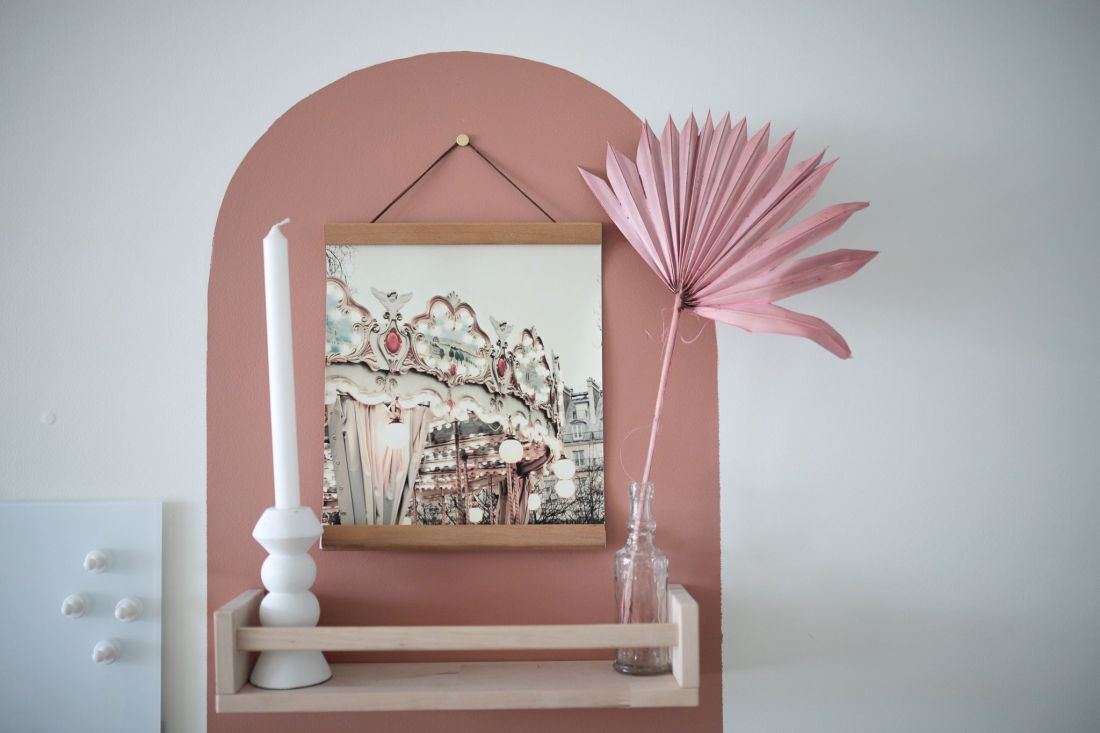 Geometric Shapes Design by popular Nashville life and style blog, Modern Day Moguls: image of a shelf hanging on a wall with a pink geometric shape design.