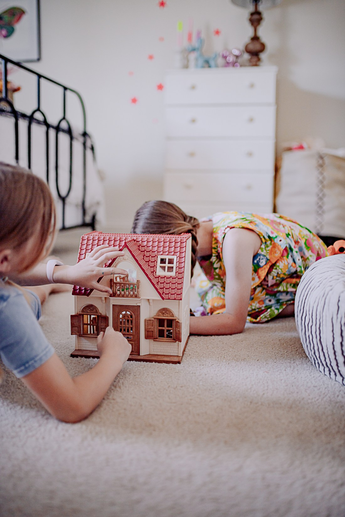 Kids Room by popular Nashville life and style blog, Modern Day Moguls: image of two young girls playing with a Calico Critters house.