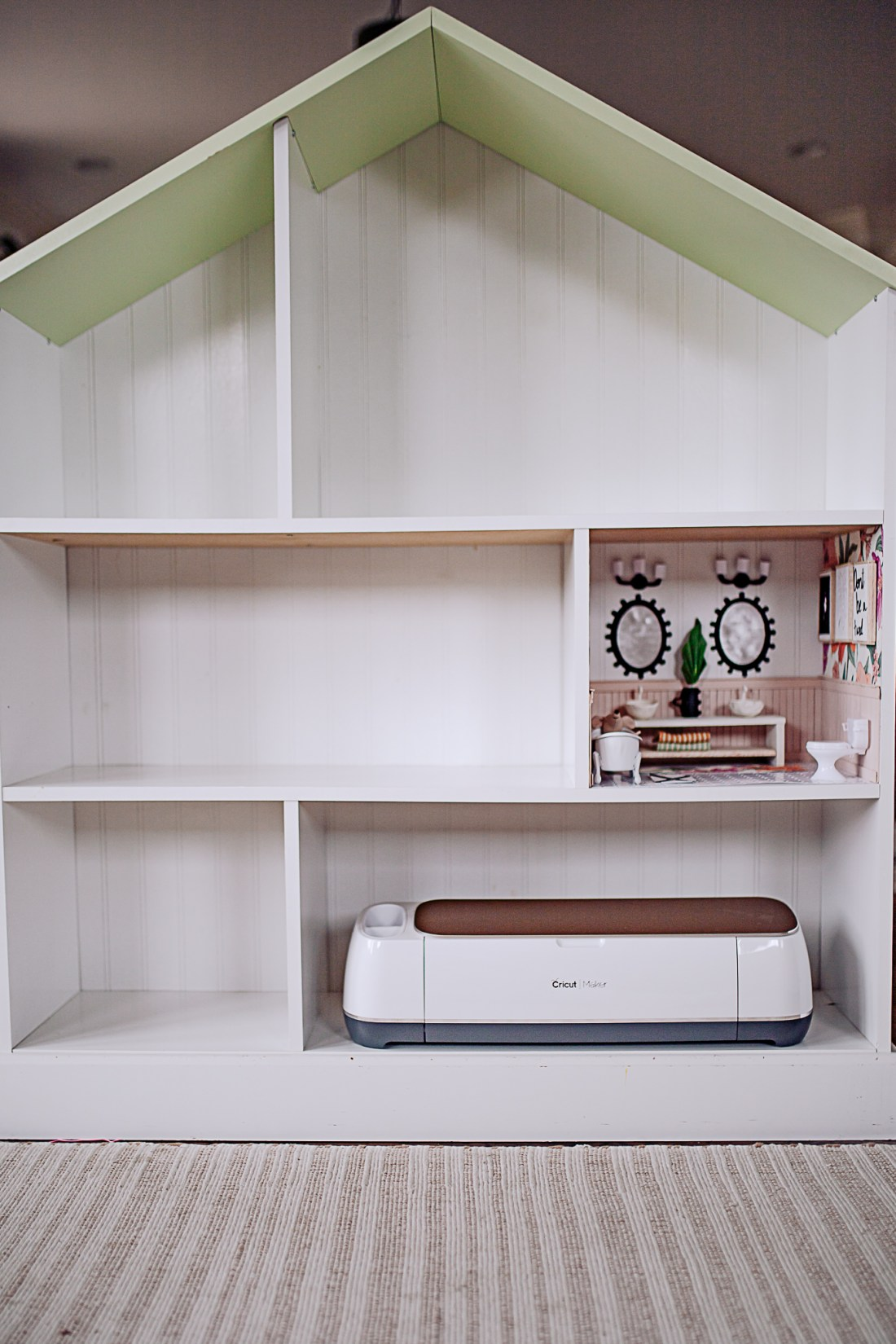Dollhouse Accessories by popular Nashville life and style blog, Modern Day Moguls: image of a white dollhouse and a Cricut machine.