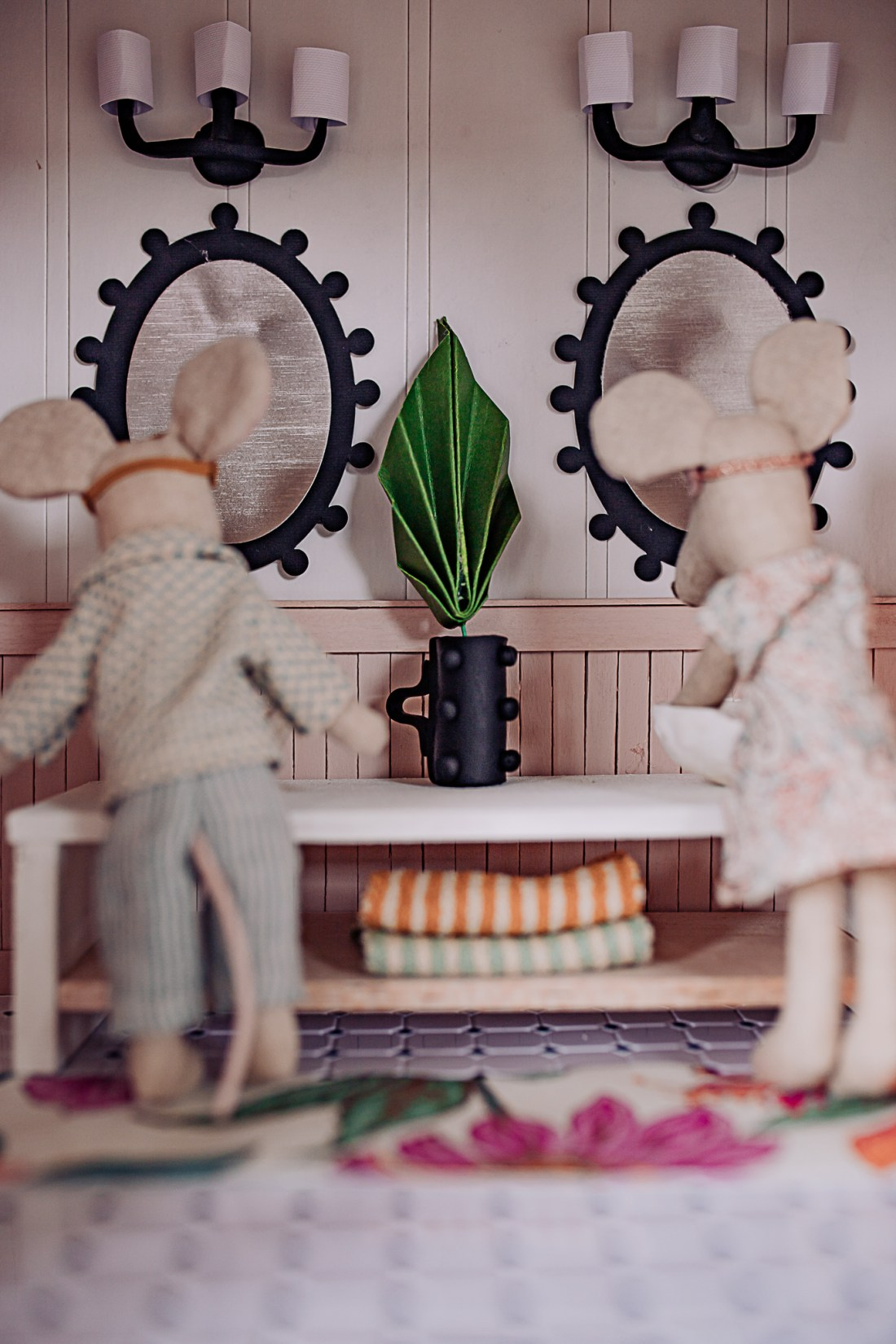 Dollhouse Accessories by popular Nashville life and style blog, Modern Day Moguls: image of two toy mice in a dollhouse bathroom.