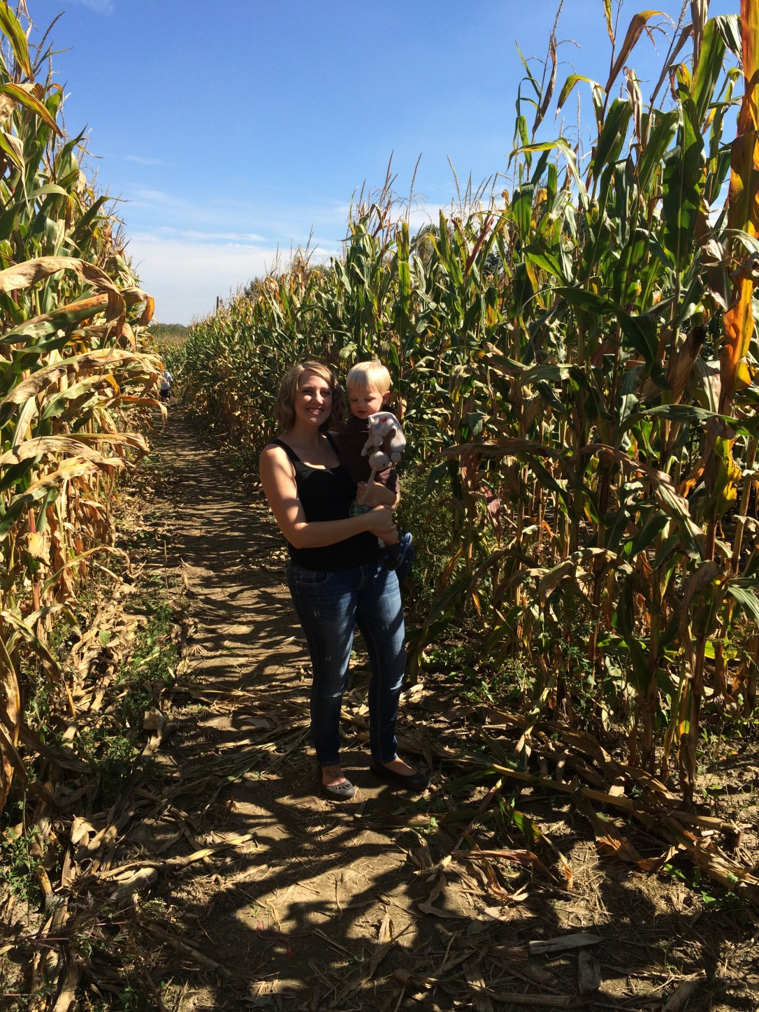 Audrey and Liam standing a field of corn