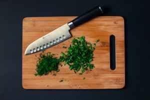 food-vegetables-wood-knife herbs chopped