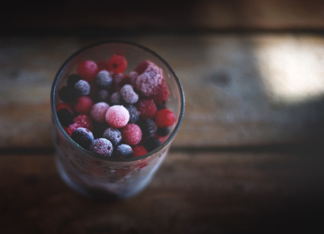 Frozen berries in glass
