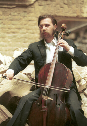 Vedran Smailovic playing in the destroyed building of the National Library in Sarajevo, 1992.