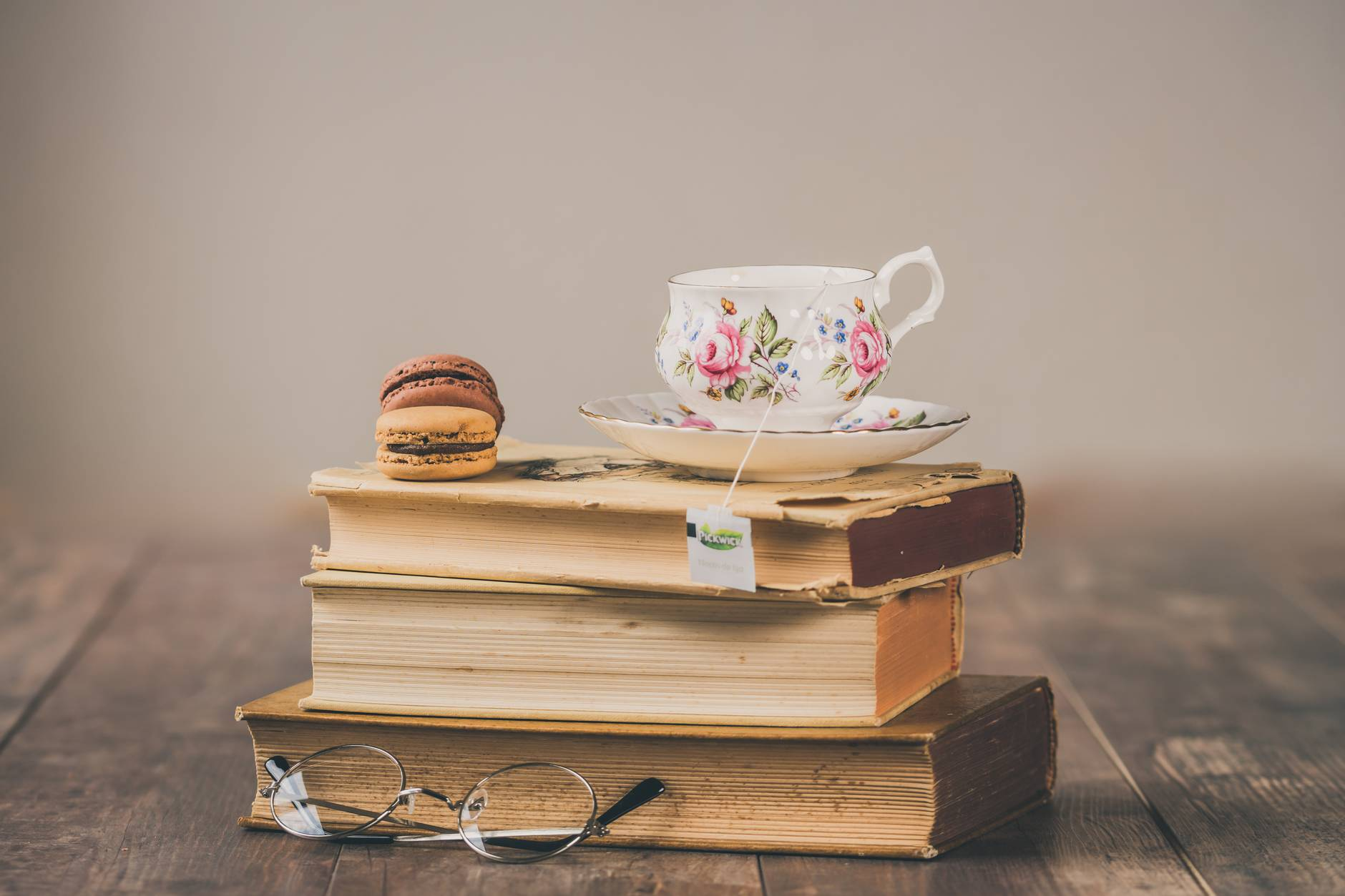teacup on top of books
