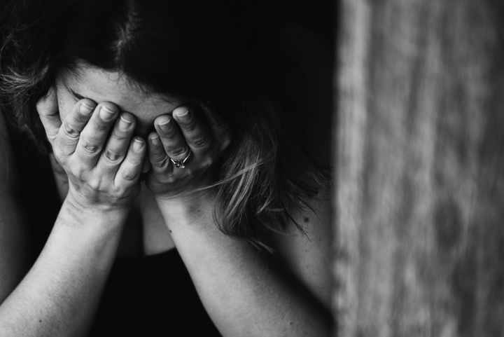 what is crisis fatigue grayscale photography of crying woman