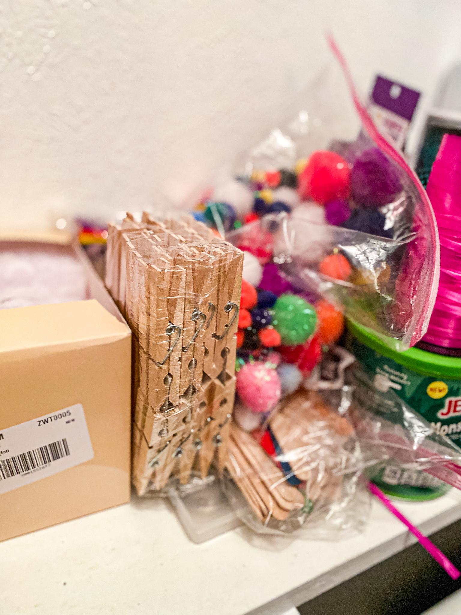 Homeschool Closet Materials - Clothespins and Pom-pom balls and craft supplies