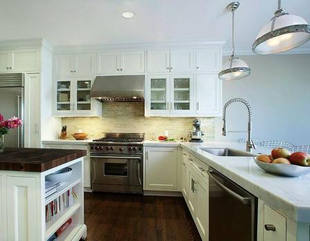An all-white kitchen with stainless steel appliances for kitchen remodeling