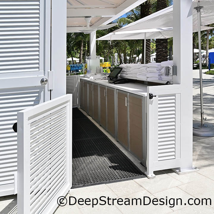 DeepStream's custom fixture, a counter with cabinets to store clean pool towels made with recycled plastic lumber