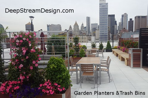 Wood garden planters with privacy screen make a cozy Manhattan rooftop patio