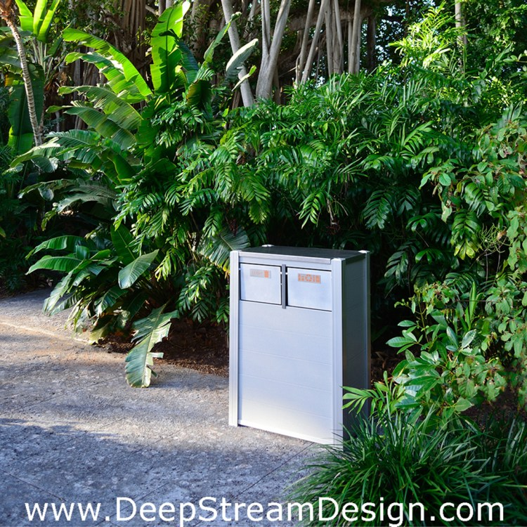Example of a DeepStream's modern combination Recycling and Trash Receptacle made with recycled plastic lumber, marine anodized aluminum and stainless steel for maintenance free use in a tropical garden