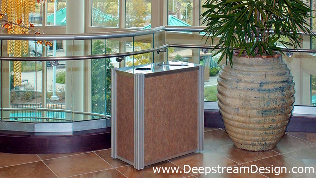 DeepStream modern combination recycling receptacle and trash bin with 3form Varia ion Green Tea resin panels in the lobby of a 5 star hotel