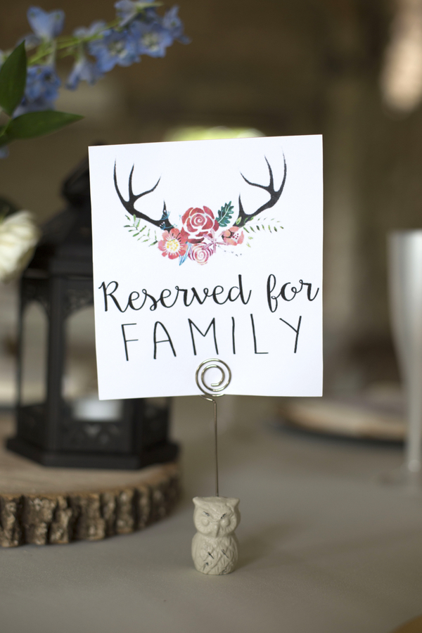 The coupled used a cute logo with antlers and flowers for their country chic wedding.