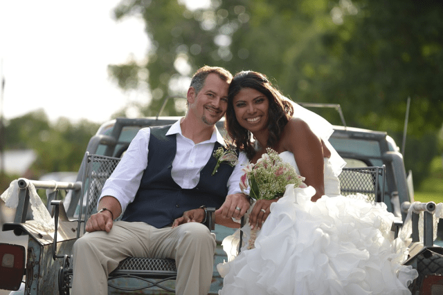 bride and groom in the back of pickup truck