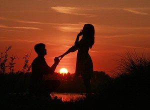 couple getting engaged at sunset