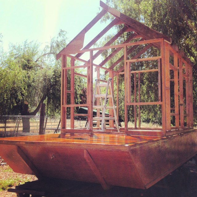 Shantyboat cabin framing comes together from reclaimeddd materials