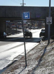 Detail of bus stop shows no sidewalk, no connection to surrounding infrastructure.