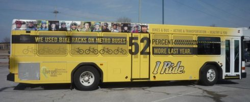 Metro Bus half wrapped with I Ride advertisement that reads -we used bike racks on metro buses 52 percent more last yea