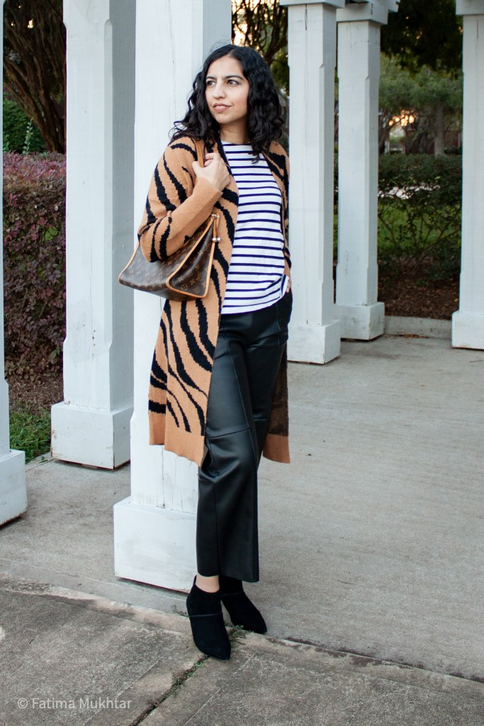 fall cardigan outfit idea zebra print sweater and faux leather pants