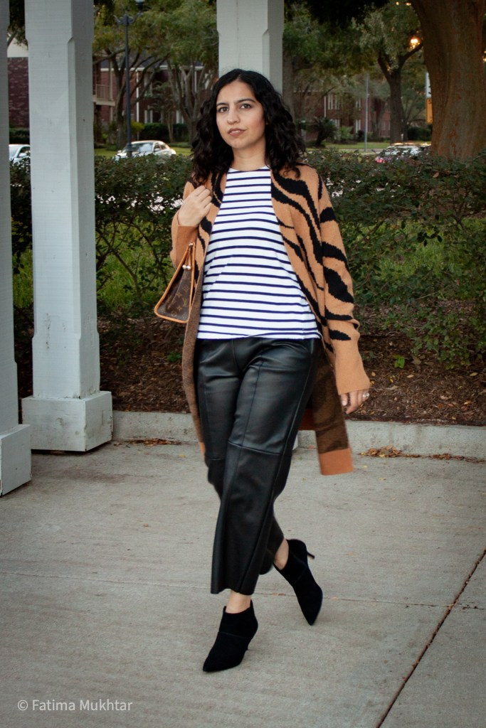 zebra print cardigan with striped shirt and faux leather pants
