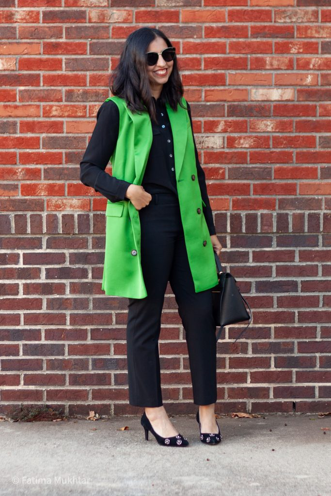 cute professional outfit trench vest over black blouse and pants