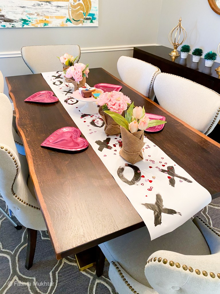 Valentine's Day tablescape xoxo runner heart plates pink flowers