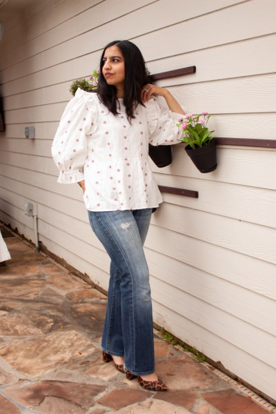 how to wear bootcut jeans now ruffle top blue jeans