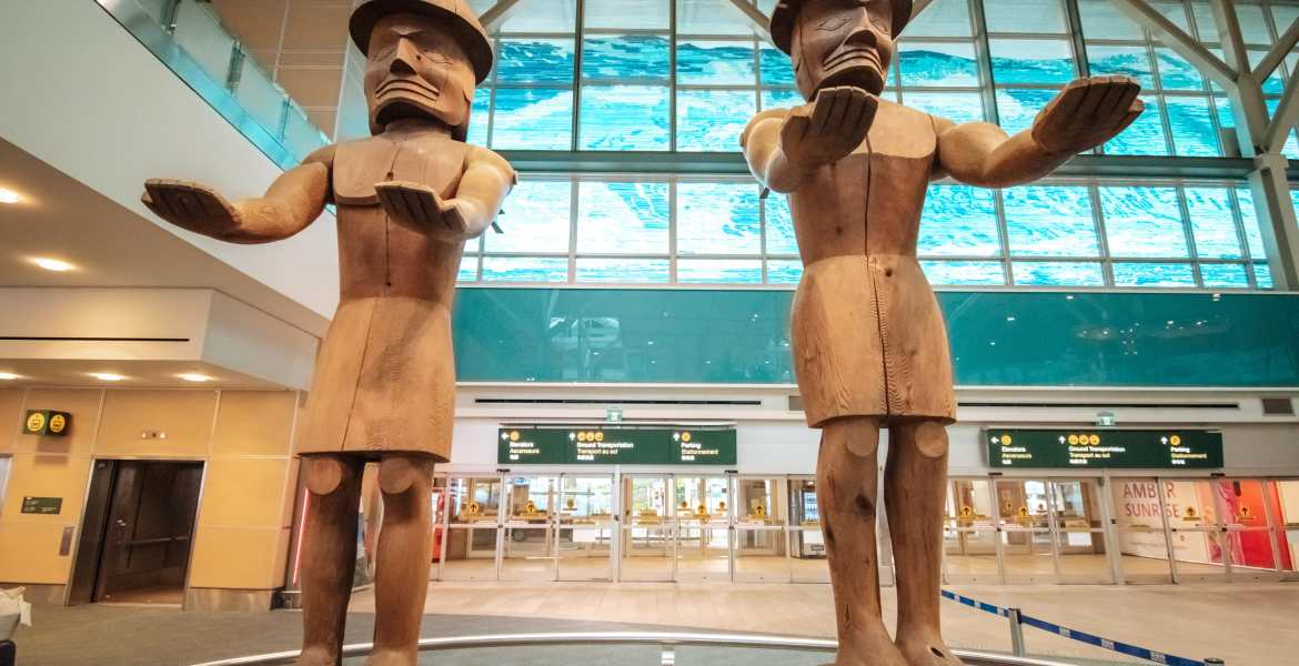 Welcome Figures by Joe David, 1986, at the Vancouver International Airport.