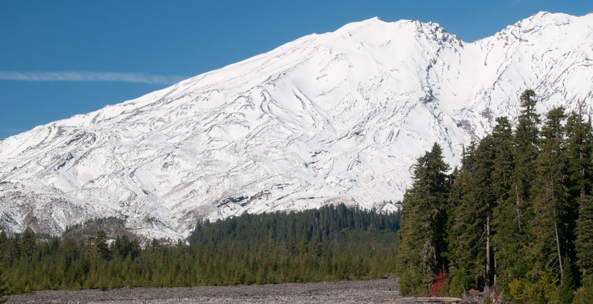 Gifford Pinchot National Forest Hikes - Lava Canyon Trail #184. This photo shows the Southern side of Mt. St. Helens in Washington State, including the debris fields left after the 1980 blast melted ice and snow and sent a flood of debris that carved out the Lava Canyon. The Lava Canyon Trail provides a challenging, yet rewarding view of Muddy Creek and the canyon re-carved by the melted ice and rock that resulted from the volcanic eruption.