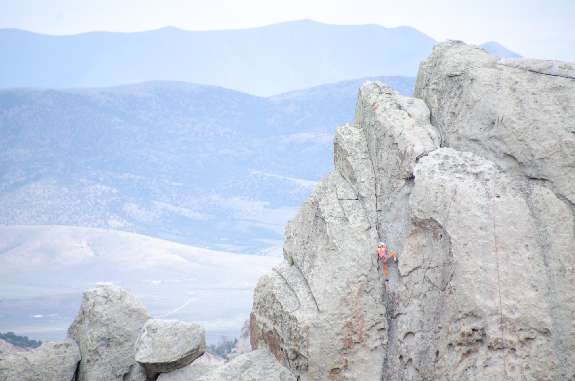 Idaho National Parks - City of Rocks National Reserve. A rock climber ascends a vertical rock face in the center of the City of Rocks and Idaho's Castle Rocks State Park.