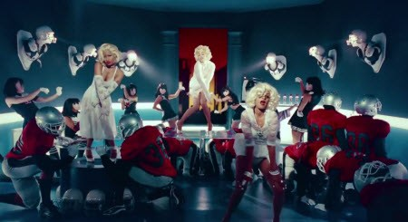 In the video for Give me Your Luvin', Madonna, Nikki Minaj and M.I.A. are dressed as Marilyn Monroe, the ultimate prototype of Sex Kitten Programming.