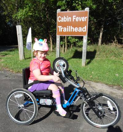Photo: Pictured: Real Life Expert's daughter, Elizabeth, on her adapted bicycle.