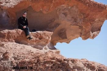 Sarah resting while rock climbing