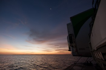 Sunset with the trucks on the front of the bage on the Amazon