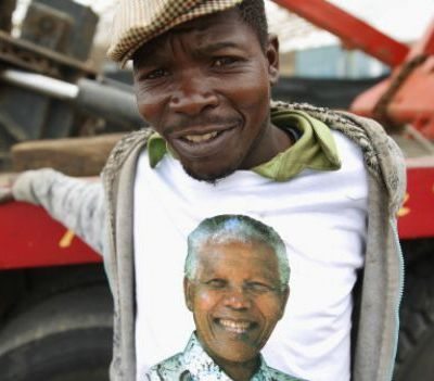 A man wears a Nelson Mandela t-shirt, one of many given away on Mandela's funeral, Dec. 14 in Mthatha, South Africa. Photo: Chip Somodevilla/Getty.