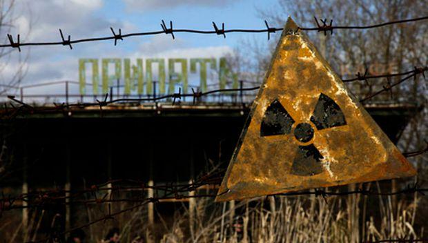 A Chernobyl radiation warning sign hangs outside a café. Photo: Wiki/VOA public domain