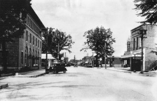 Barely visible in this photo of Broad St, The Stand Theater opened in 1915 and closed in 1955.