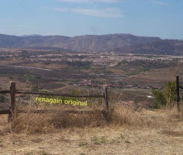 scenic view of the city below and mountain range in the background