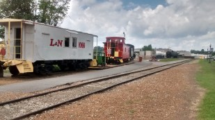 Having the train cars gives the museum authenticity.