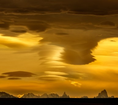 Panorama of Mt Fitz Roy and Cerro Torre under lenticular clouds at sunset - Mirador Julio Heredia