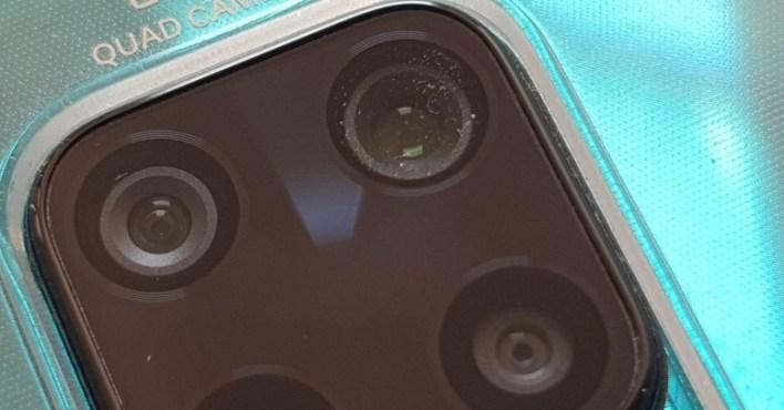 مشكلة دخول تراب في كاميرا ريدمي نوت 9S