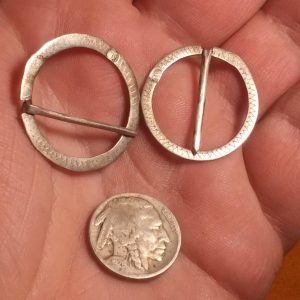 Iroquois forged silver brooches