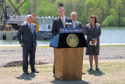 Lt. Governor Robert Duffy (at podium), Congressman Paul Tonko (left), Canal Corporation president Brian Stratton (second from right), Amsterdam Mayor Ann Thane (right)