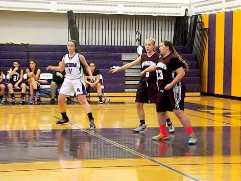 Grace Catena #21 guarded by Emily Ross #5 and Megan Patterson #33
