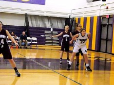 Autumn Duemler #24 guarded by Emily Washburn and Emily Ross #5