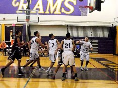 Stanavich, Pritchard, Rodriguez #21, and Andrew Druziak #3 ready for a rebound