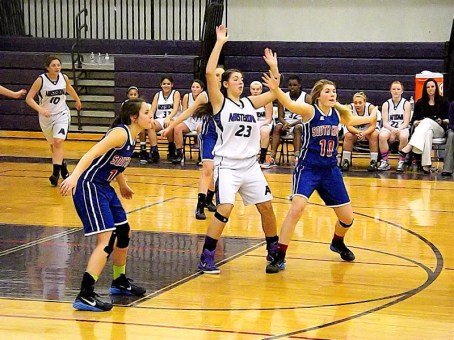 Giuliana Pritchard #23 battling Buser #14 and Rylee Coon #10