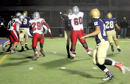 Brian Stanavich #28 takes the ball around the end of the Nisky defense