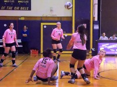 Maria Lomanto watches Morgan Durinick set the ball after a dig