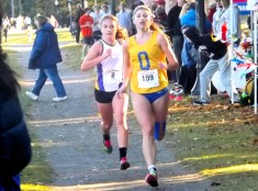 Amsterdam's Olivia Lazarou (left) and Queensbury's Sherri Metcalf battle for second place